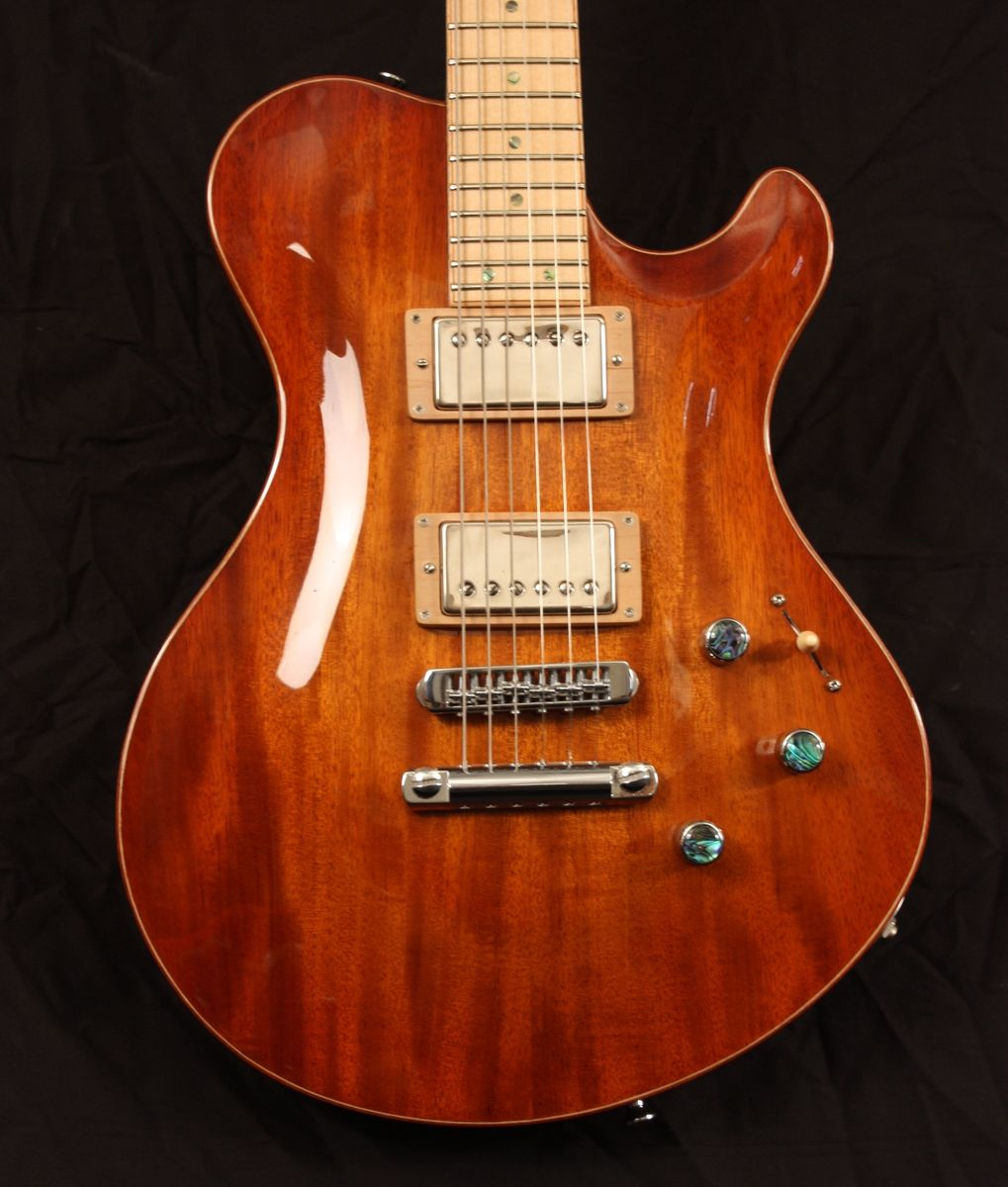 Handmade mahogany and maple carved top guitar by snider