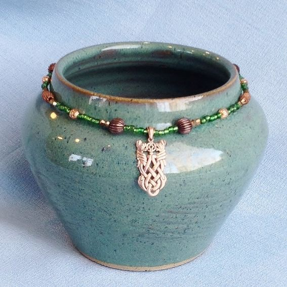 Hand Crafted Emerald And Copper Celtic Knot Necklace by