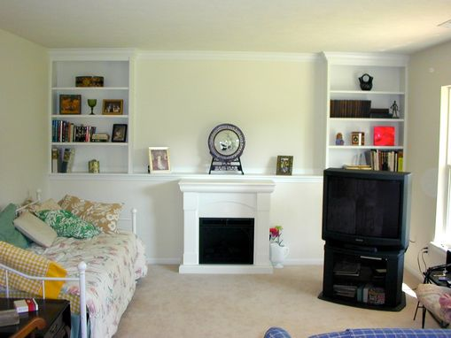 Custom Made Built-In Shelving With Crown Molding Trim