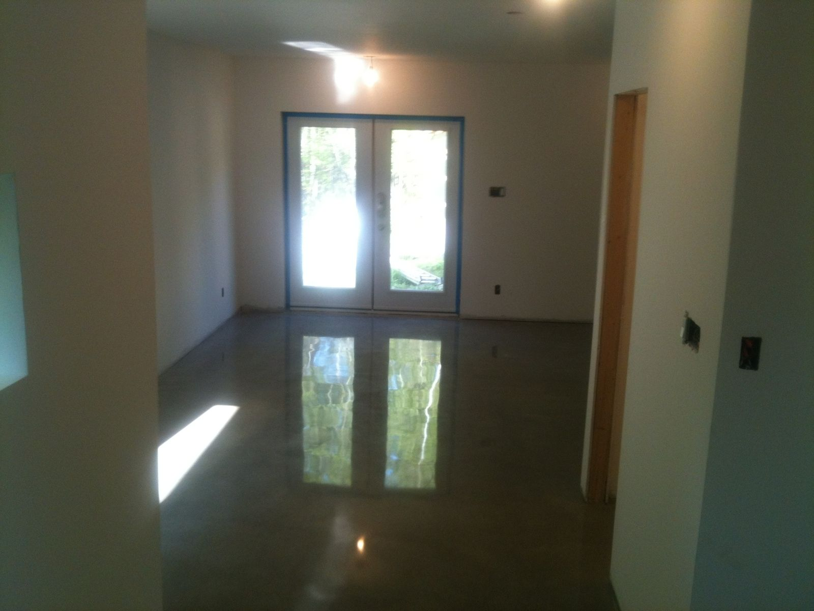 Custom topline polish residential concrete floor by custom for Residential concrete floor wax