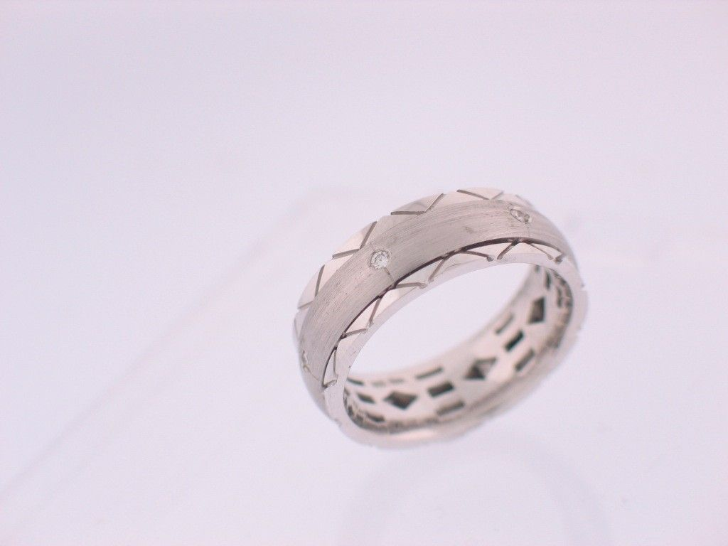 buy a custom spinning wedding ring made to order from