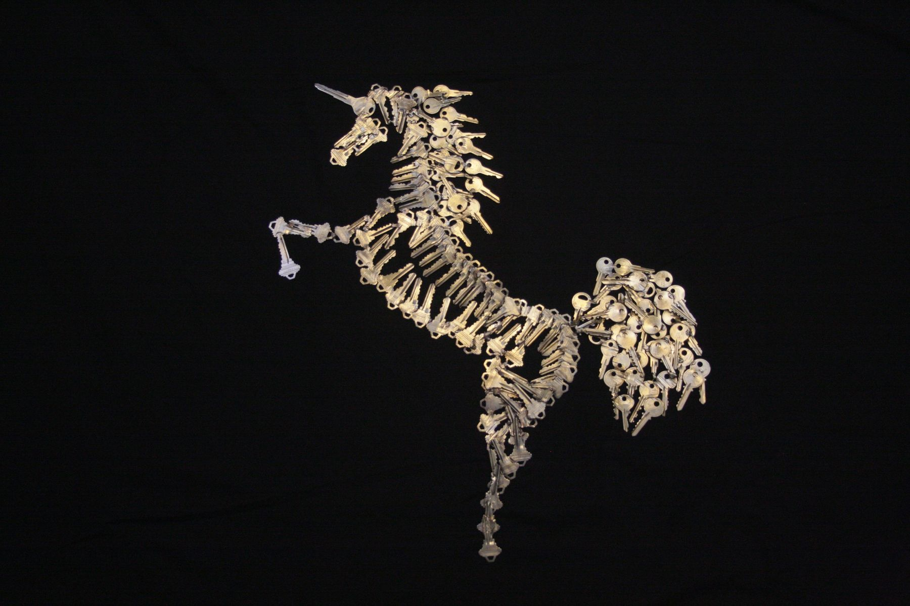 Hand made metal art for the wall unicorn sculpture by for Art made with keys