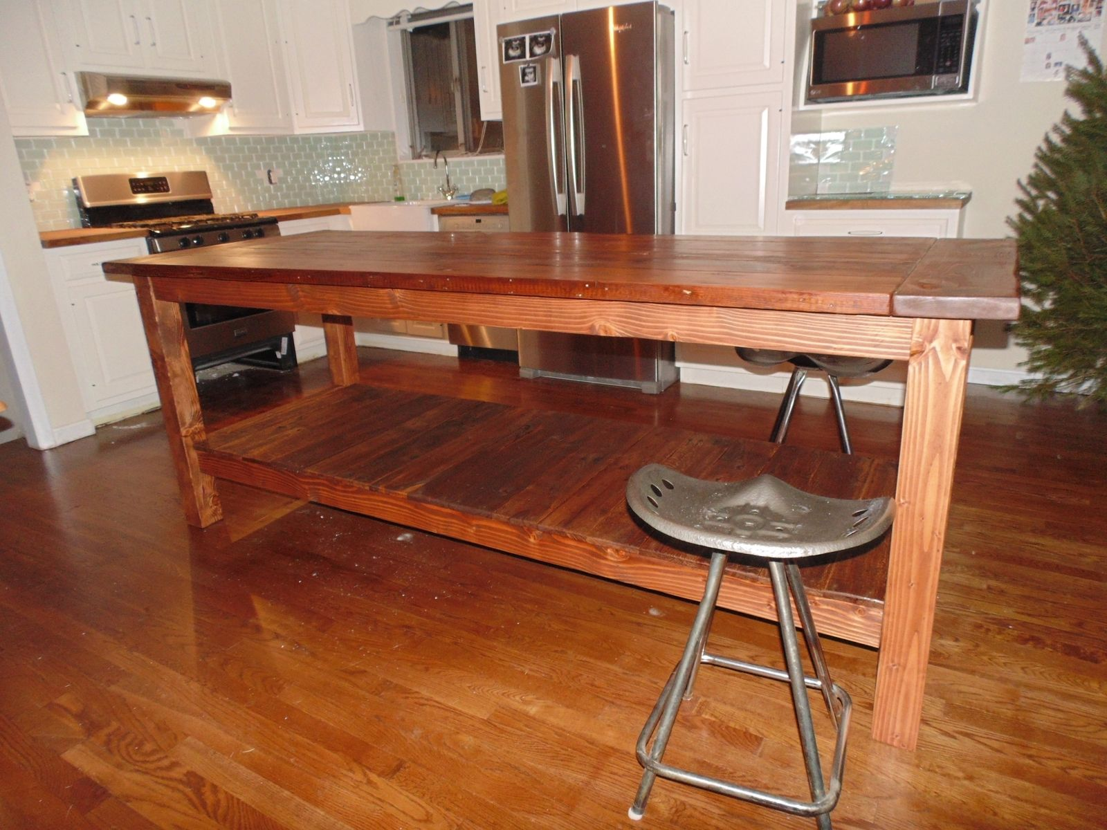 Hand crafted reclaimed wood farmhouse kitchen island by for Custom made kitchen islands