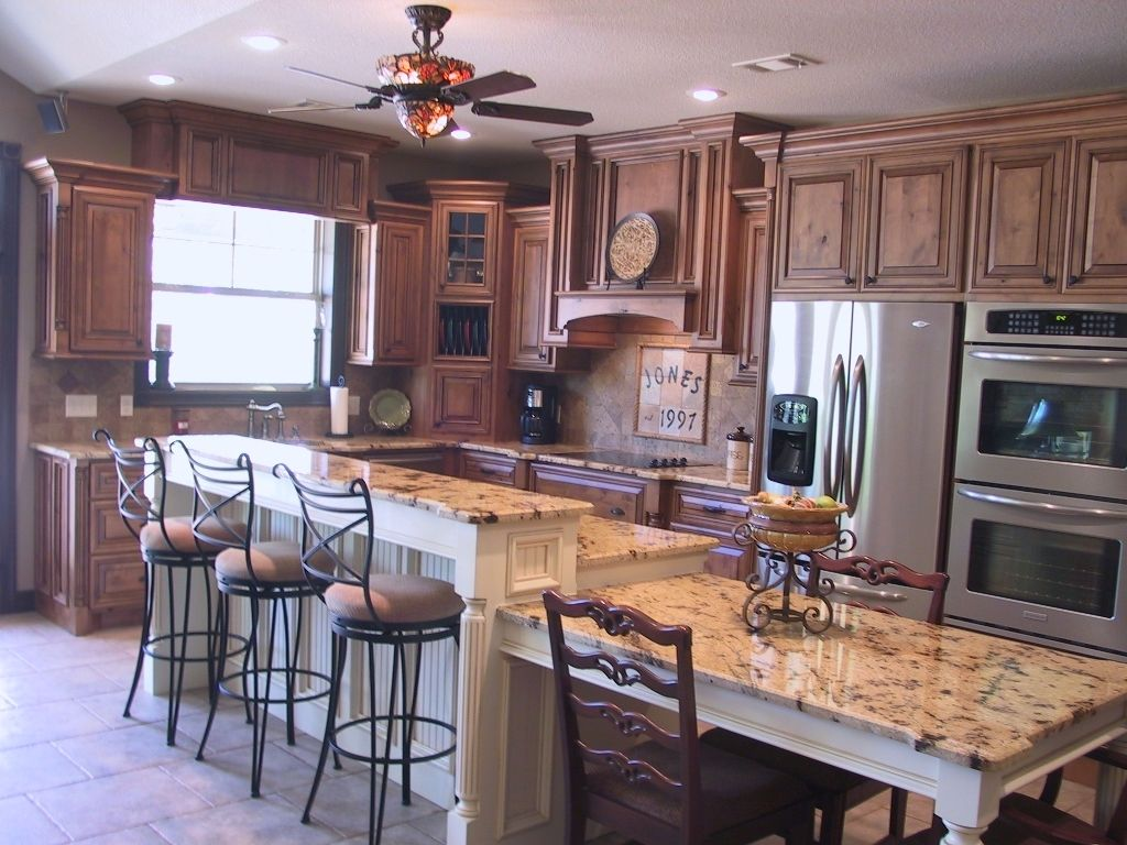 Custom Knotty Alder Stepped Kitchen by Creative Cabinetry   CustomMade