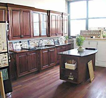 Hand crafted custom kitchen in cherry wood stained for Rosewood custom homes