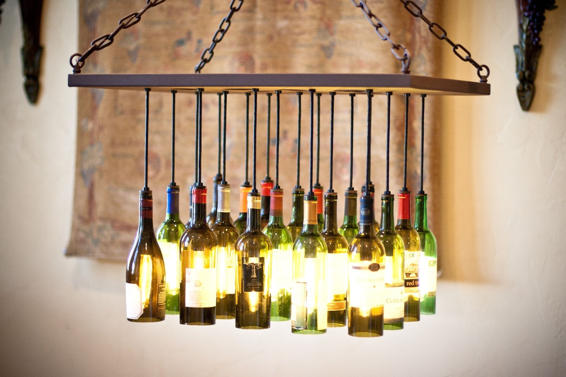 Custom wine bottle chandelier by by gordon living for Recycled decoration