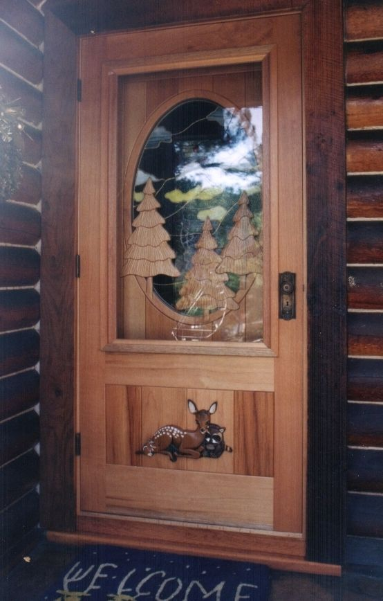 Handmade screen storm door over custom entry door by for Custom made wood doors