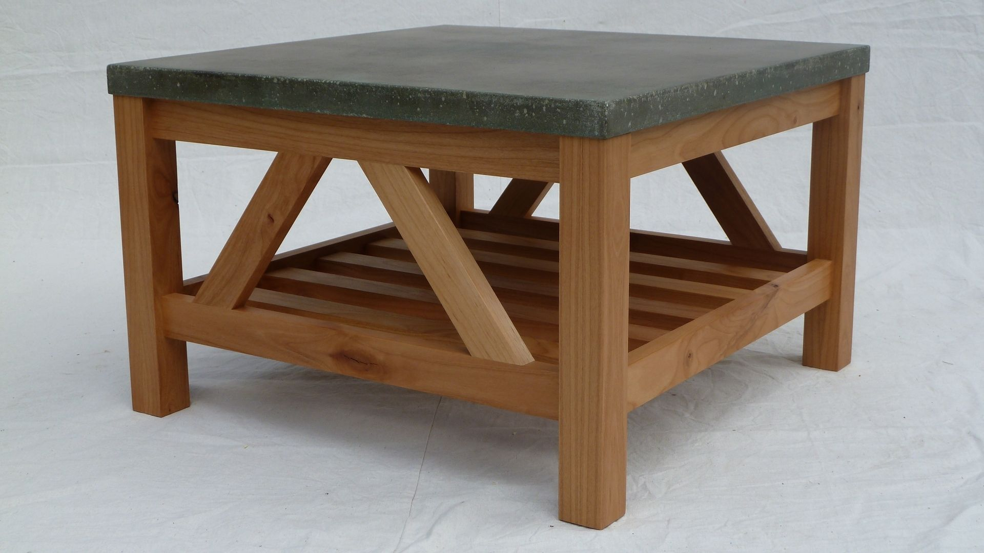 Handmade alder coffee table with concrete top by for Concrete coffee table