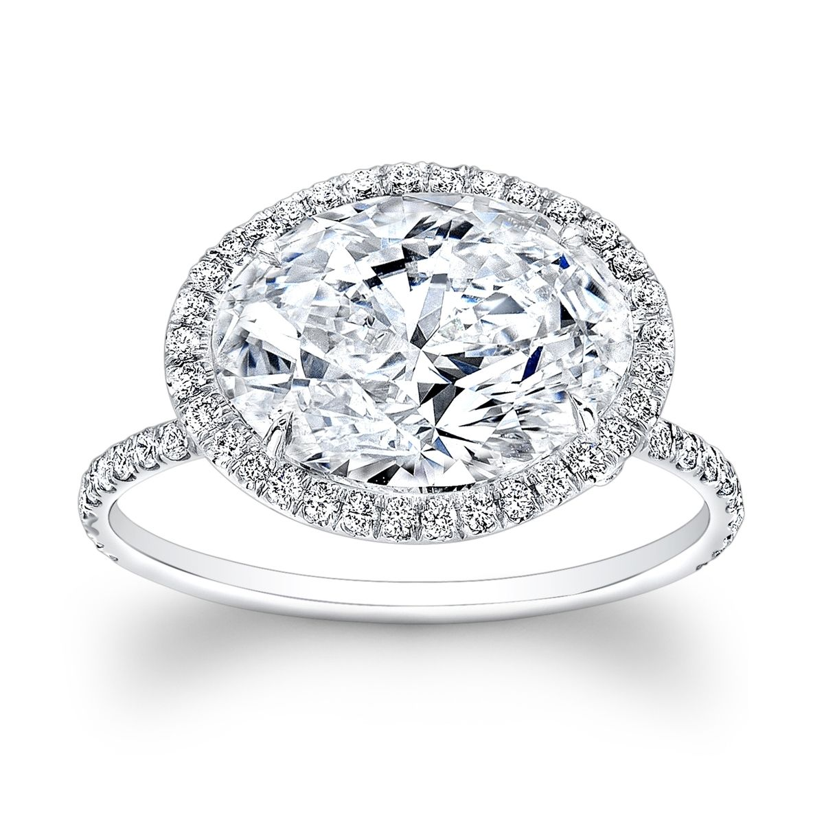 buy a handmade micro pave oval halo engagement ring made