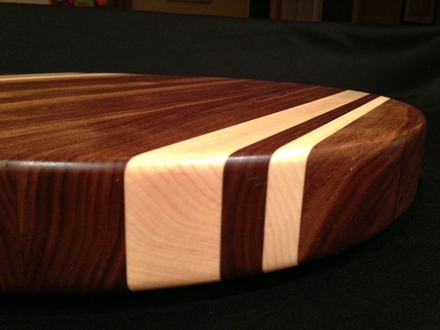 Hand Crafted Round Black Walnut Cutting Board With Rock