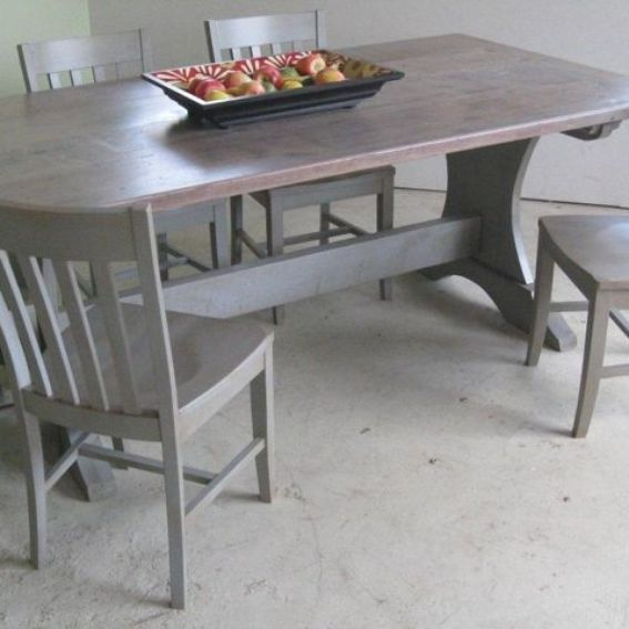 hand made trestle dining room table with driftwood finish