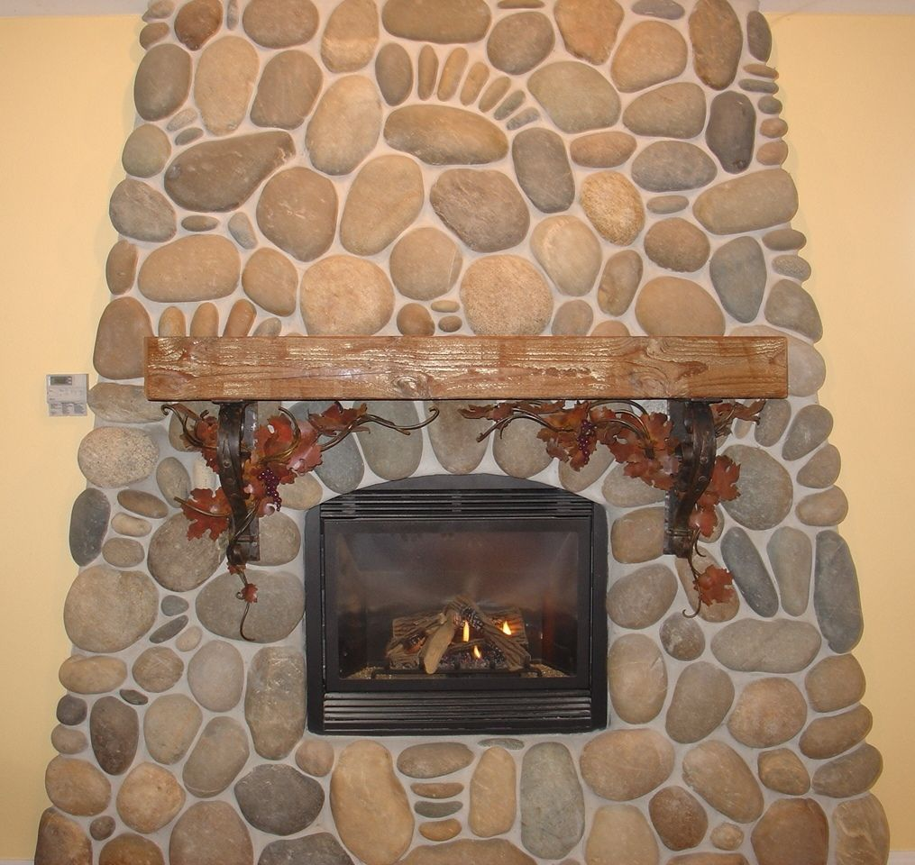 hand crafted fireplace mantel with corbels by iron willow