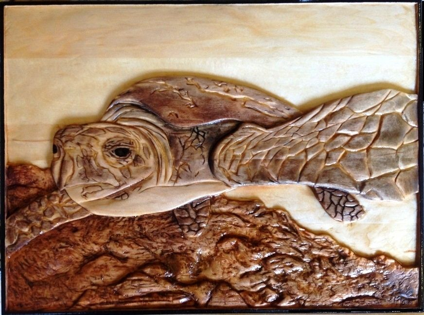 Custom made sea turtle by relief carvings mark ash