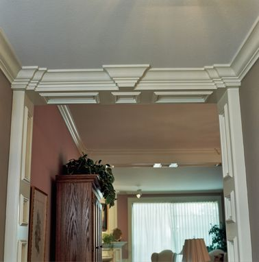 Custom Made Foyer Recessed Panel Columns With Ogee Crown Molding.