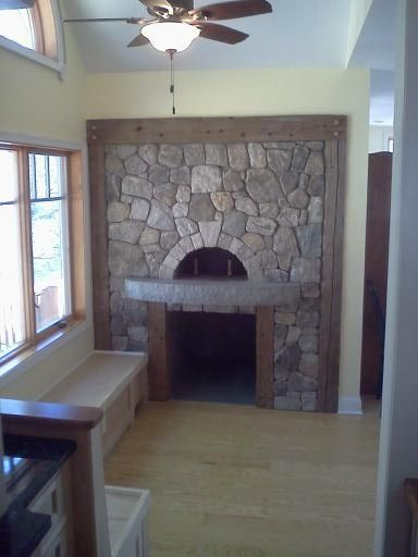 Handmade Wood Fired Pizza Oven With Rustic Stone And Wood Accents By Fineline Woodworking