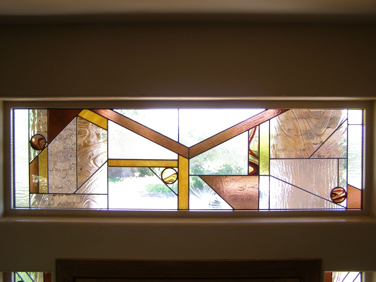 Custom made stained glass entryway transom window by for Custom transom windows