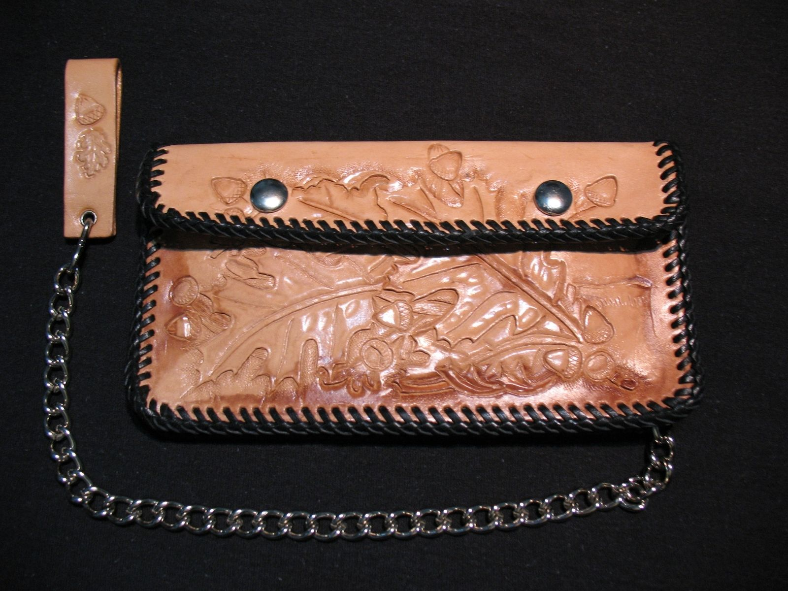 Hand made carved leather biker wallet by perfection in