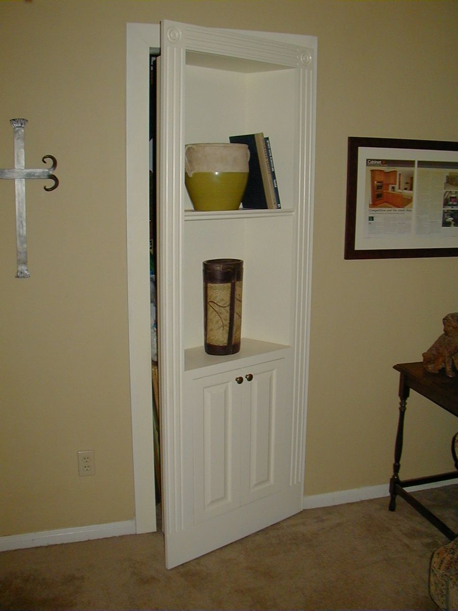 Handmade hidden bookcase door by fiorenza custom for Murphy garage doors