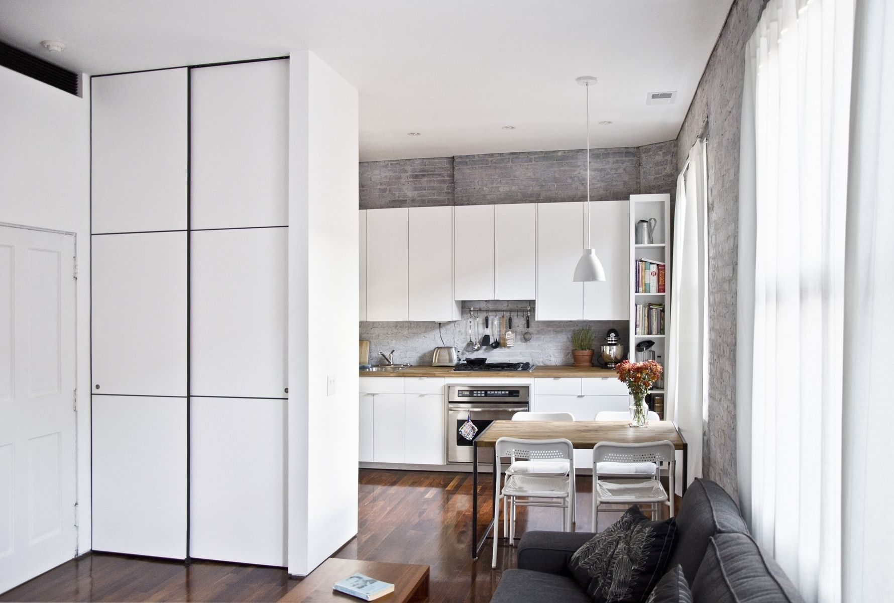 Custom floor to ceiling minimalist closet doors by mato - Small closet space solutions minimalist ...