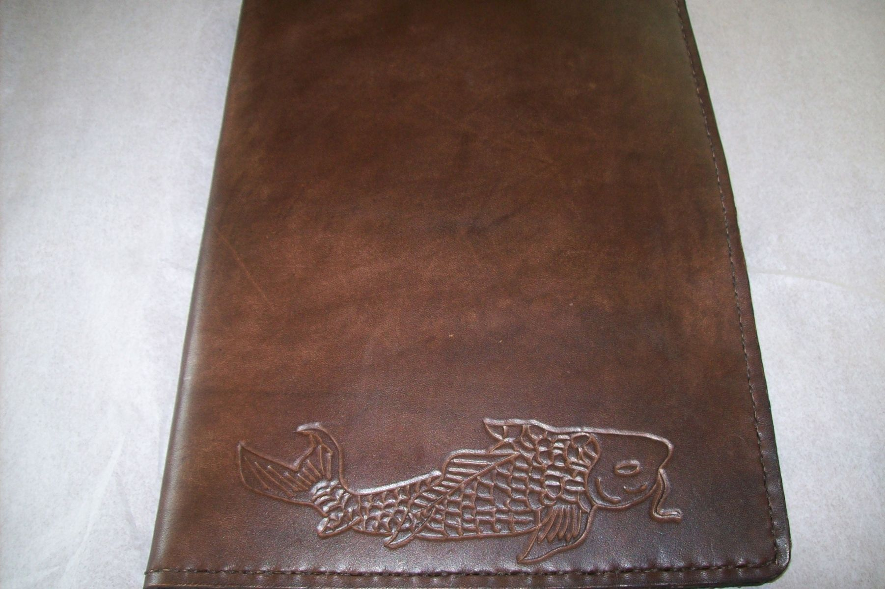 buy a hand crafted custom leather notebook cover  made to