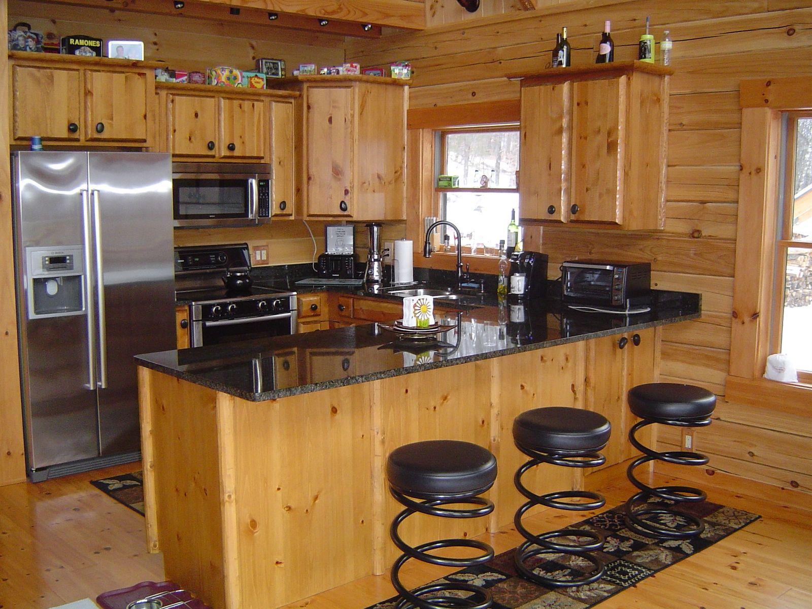 Handmade log kitchen cabinets by viking log furniture for Custom built kitchen cabinets