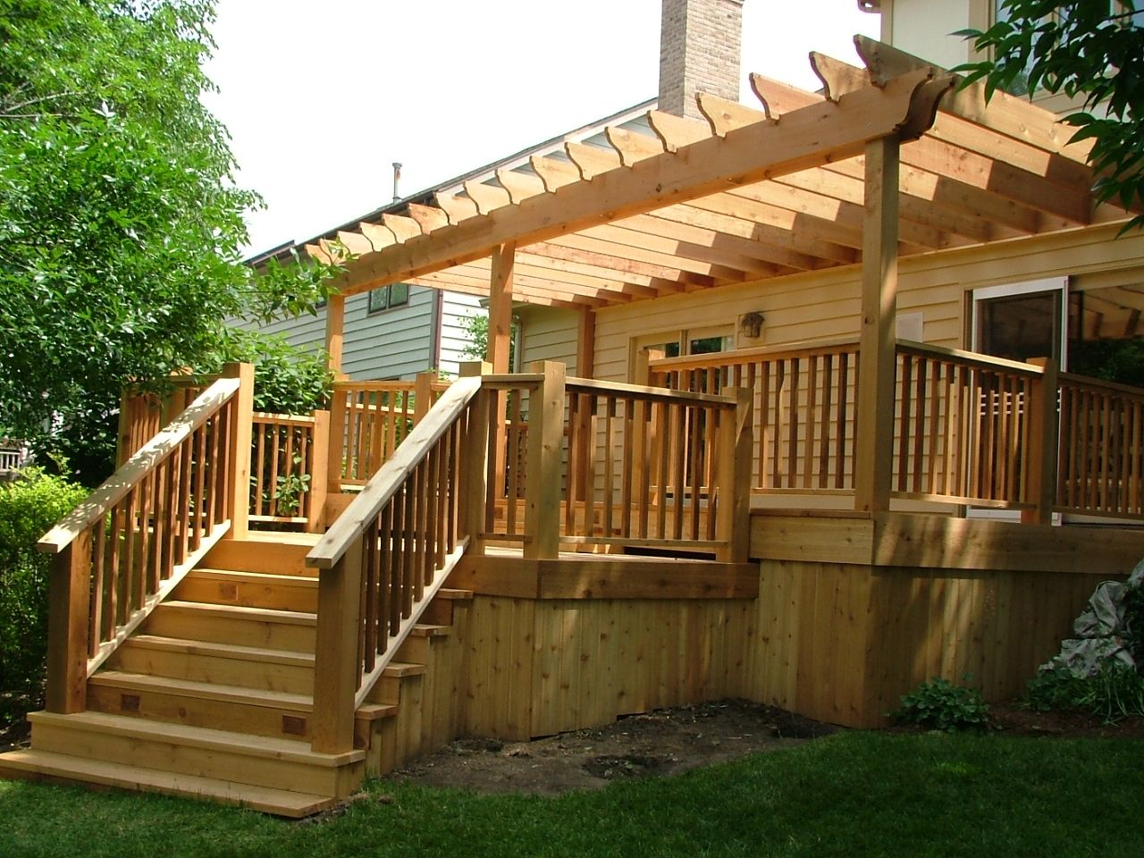 Hand crafted custom cedar deck with pergola by lee custom for Patio plans and designs