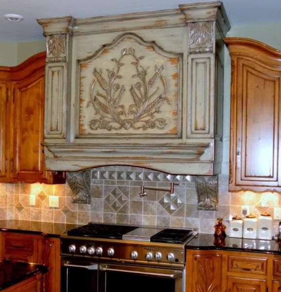 custom made hand carved kitchen vent hoodschateau