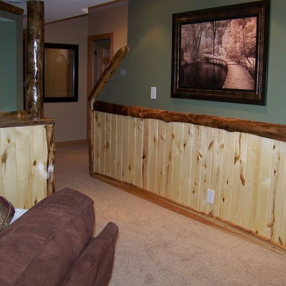 hand crafted custom refinished basement with log bar bar stools and