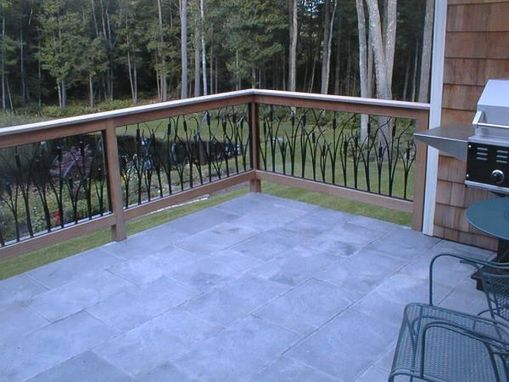 Custom Made Metal Cattail Design In Stairs And Railing