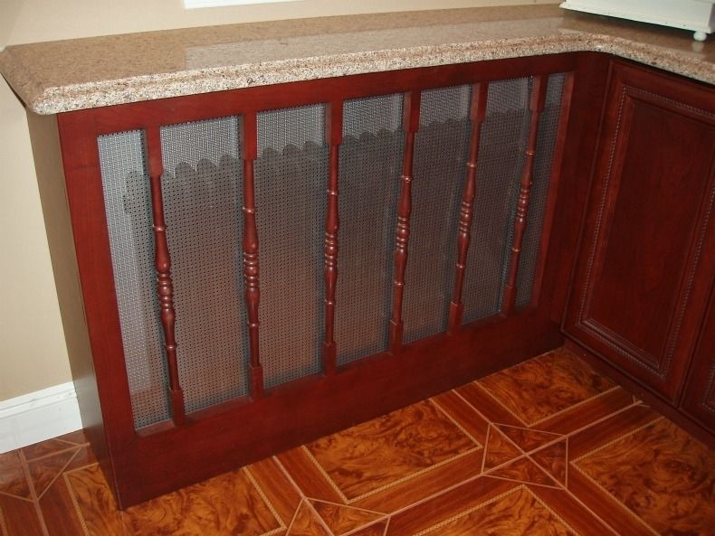 Hand crafted kitchen cabinet install with custom radiator for Cabinet covers for kitchen cabinets