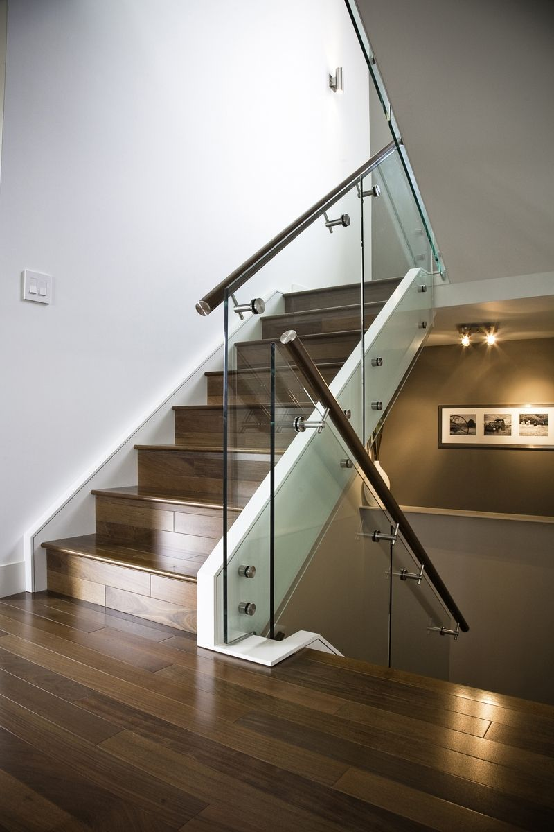 hand made maple stair with glass railing and stainless