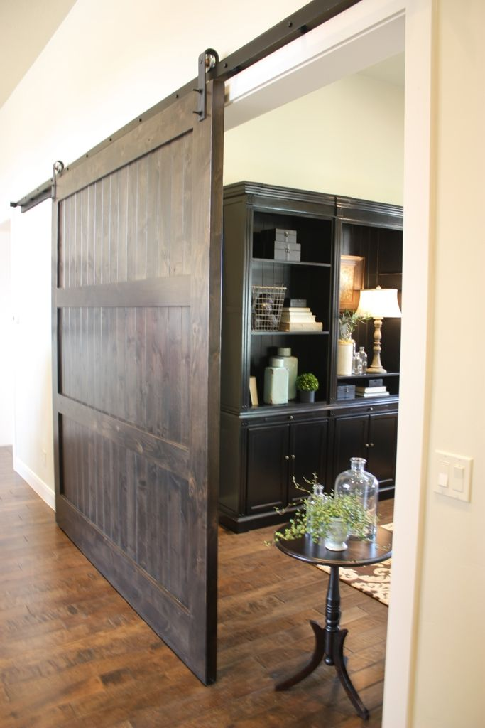 Custom knotty alder barn door by riverwoods mill for Barn door closet door ideas