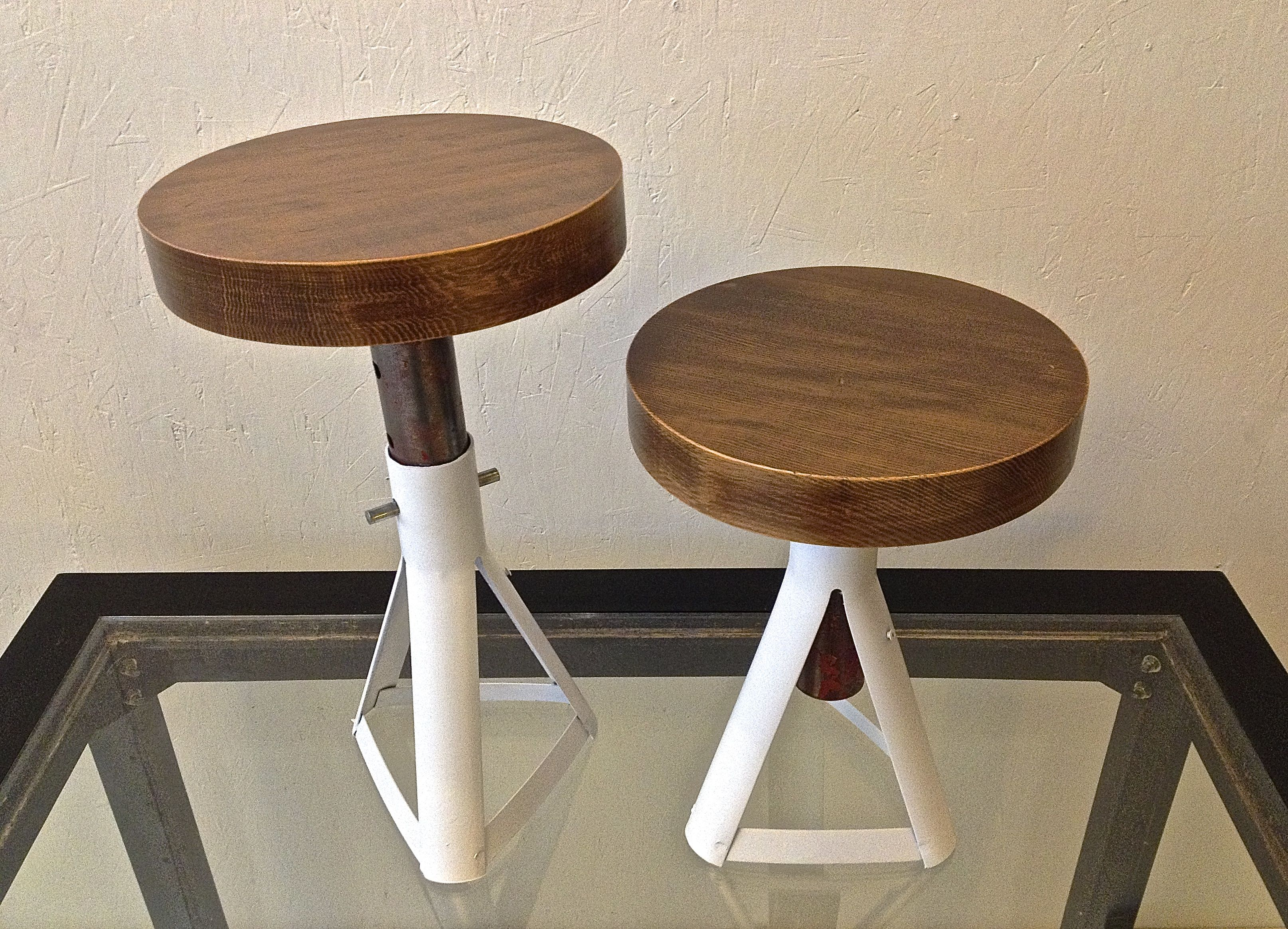 Repurposed car jack stands as stools with various wood tops