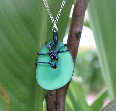 Custom Made Necklace: Blue Spirals On A Green Tagua Nut Slice