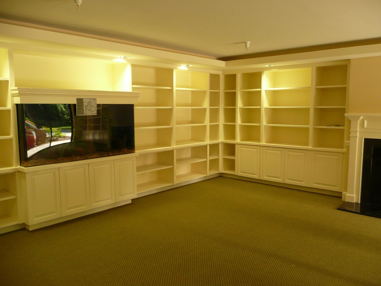 Hand Made Built In Aquarium And Bookcases And Millwork By