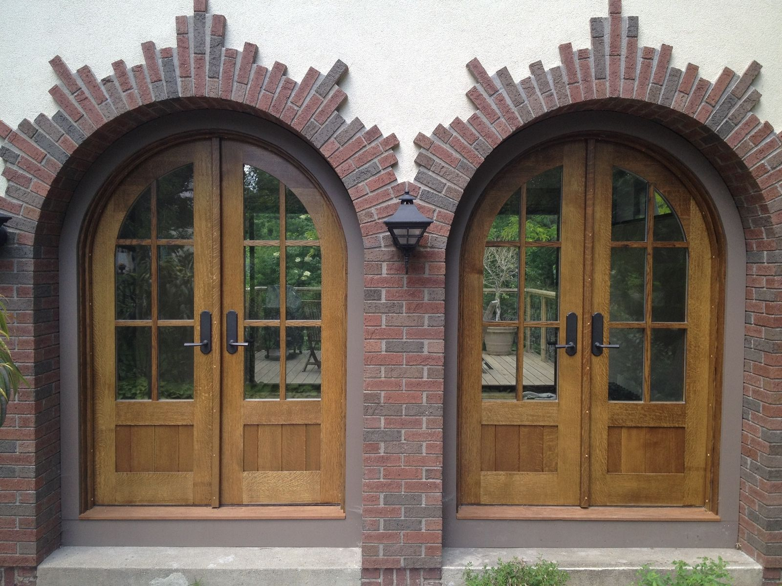 Custom arched quarter sawn white oak entry doors by for Front door with top window