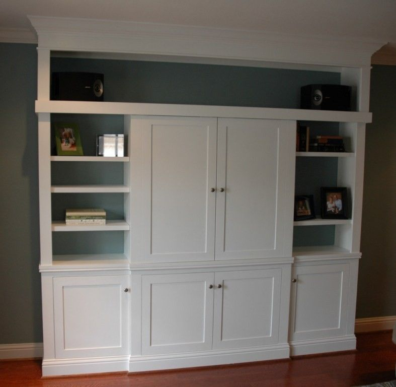 Hand made custom entertainment center with sliding doors for Built in sliding doors