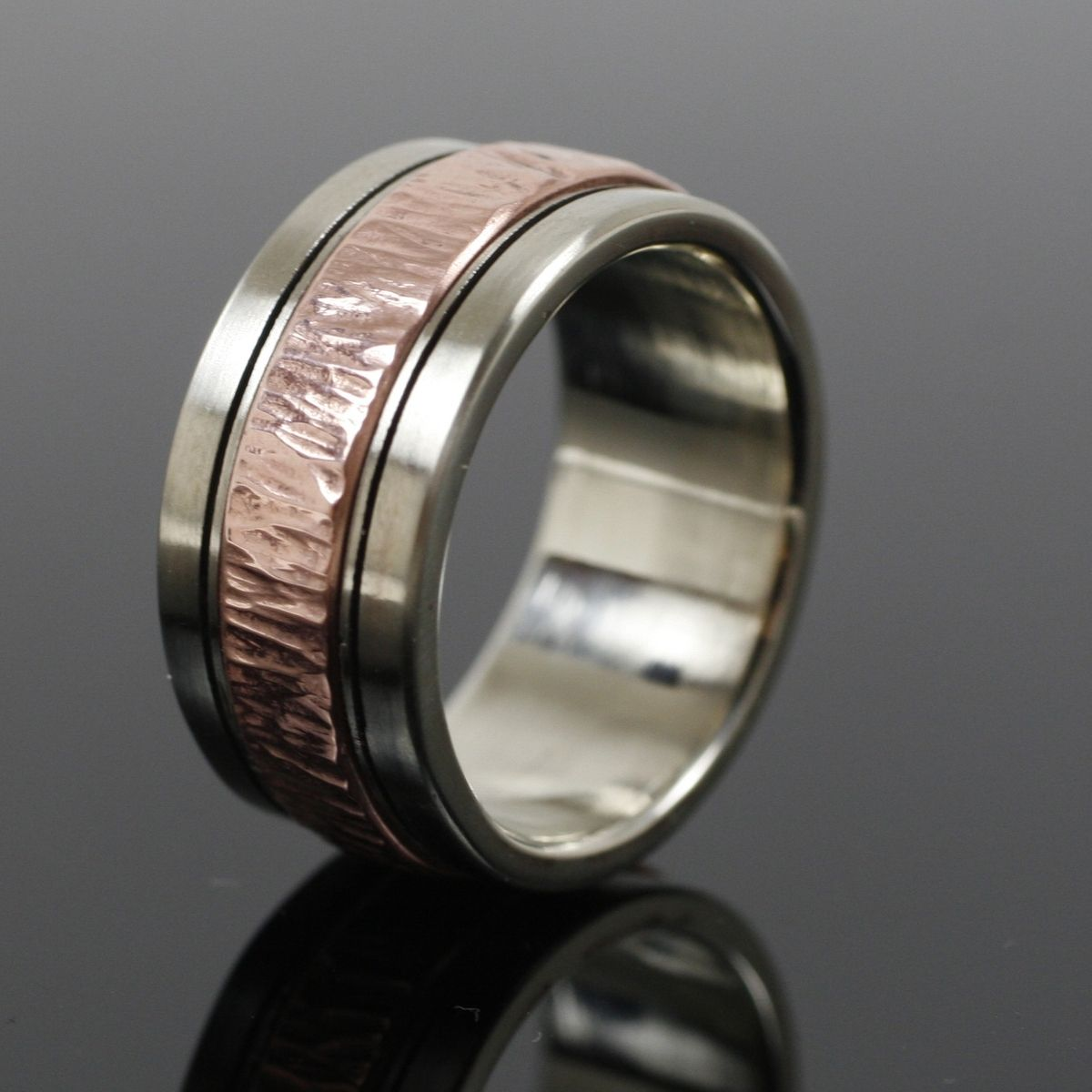 crafted mens white gold and copper wedding band by