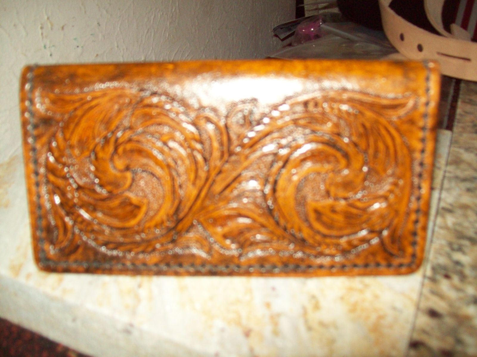 handmade hand tooled leather check book cover by the