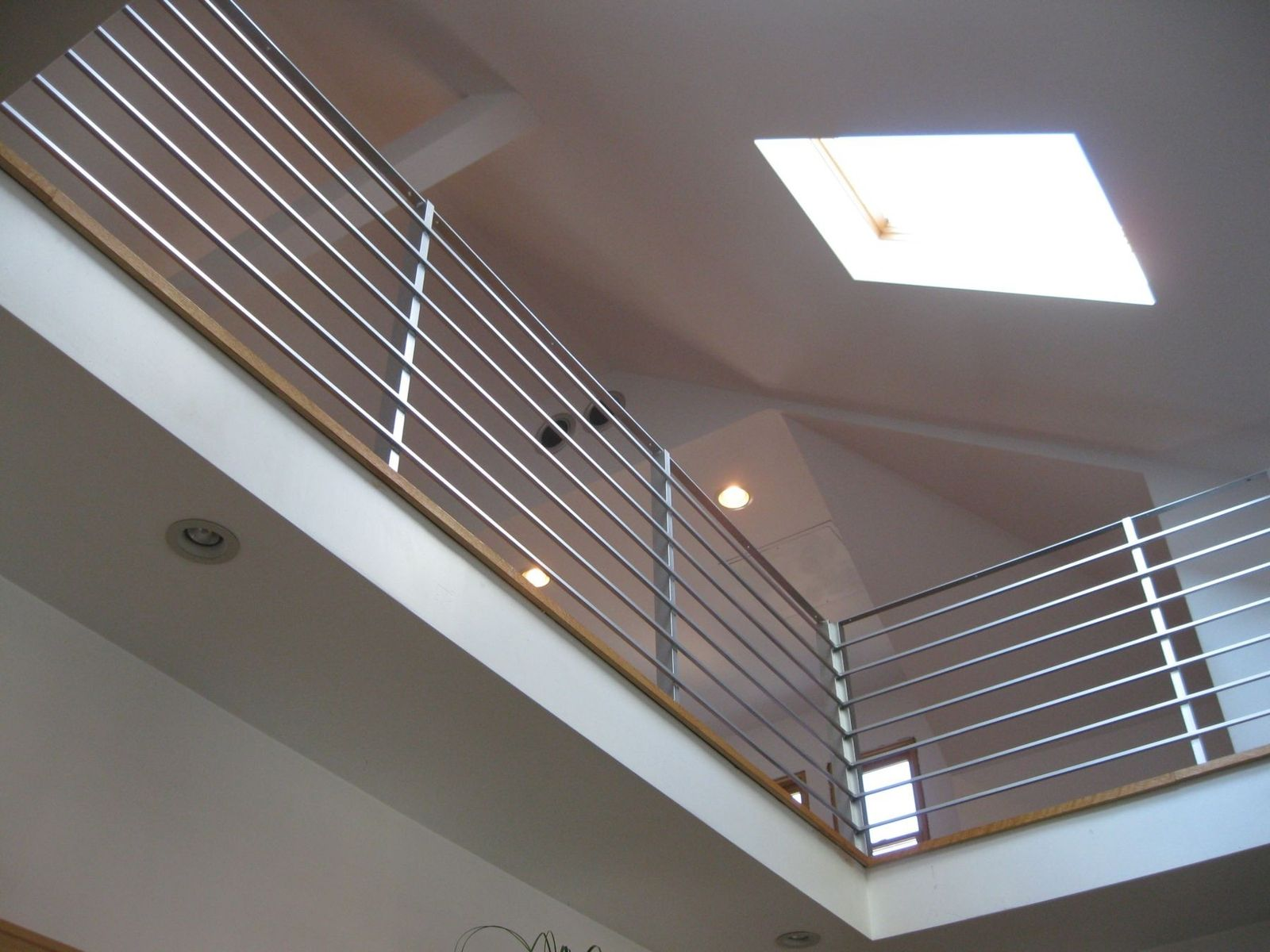 Hand made modern interior railing by bader art metal for Indoor fence design