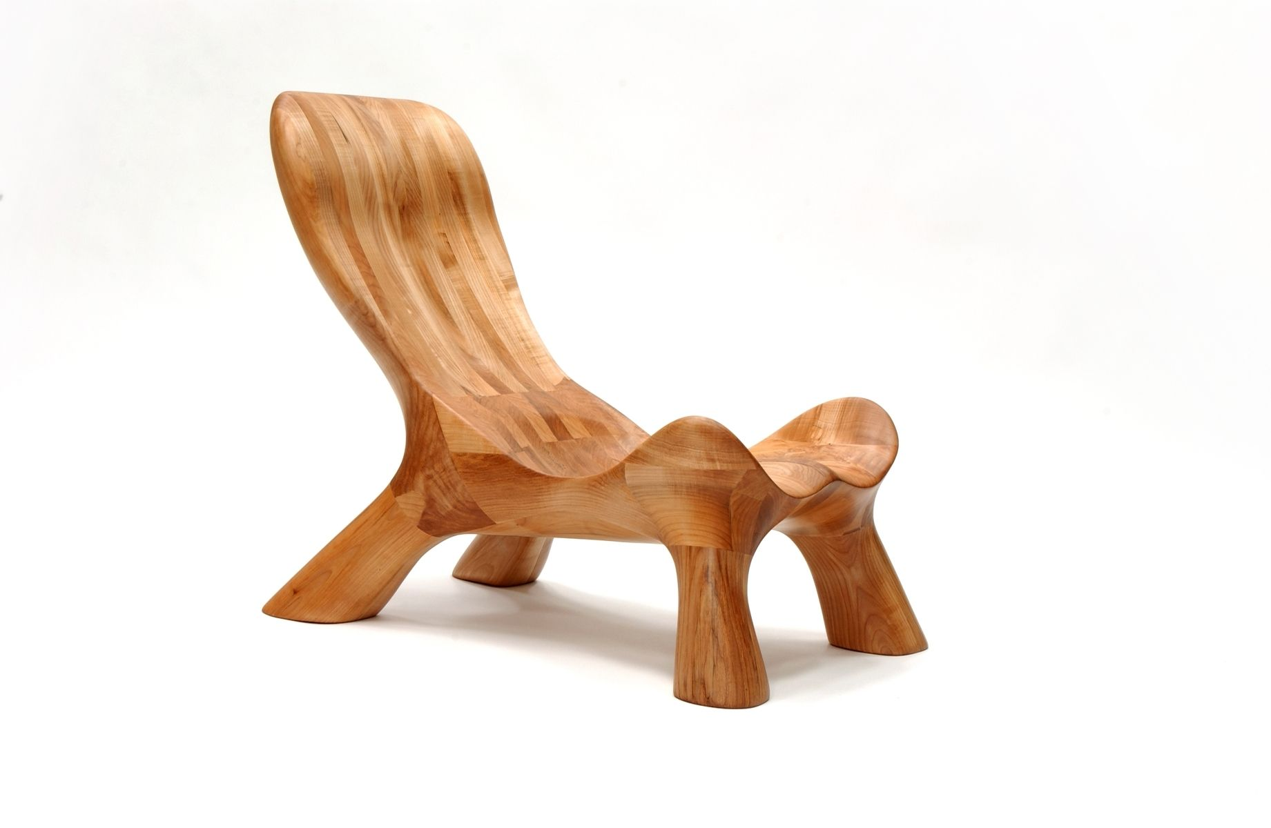 Handmade curvechair organically carved solid wood for Carved wooden chaise