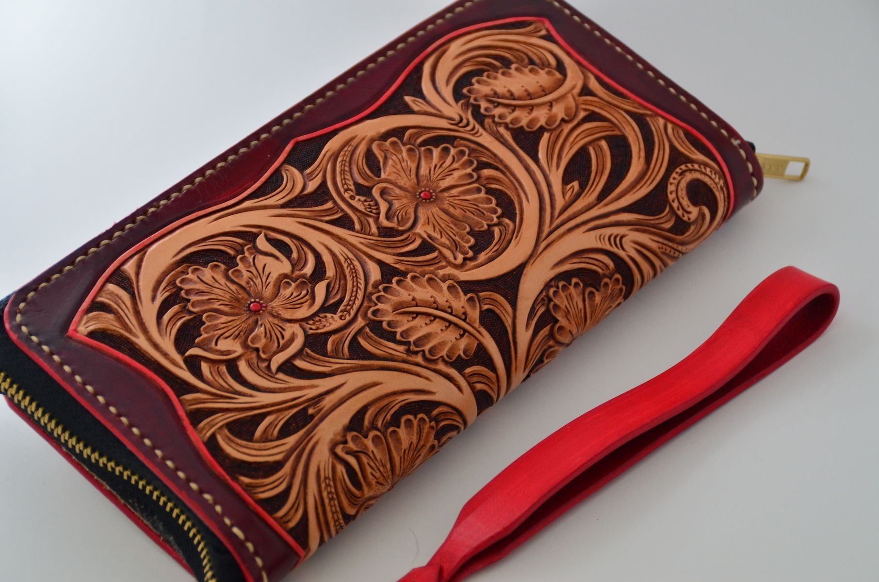 Custom hand made carved leather wallet by rzleathercraft