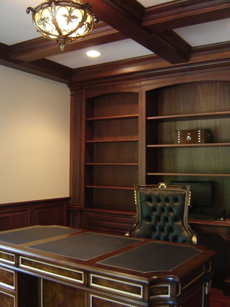 Custom mahogany home office with wainscoting and beam Custom home office design