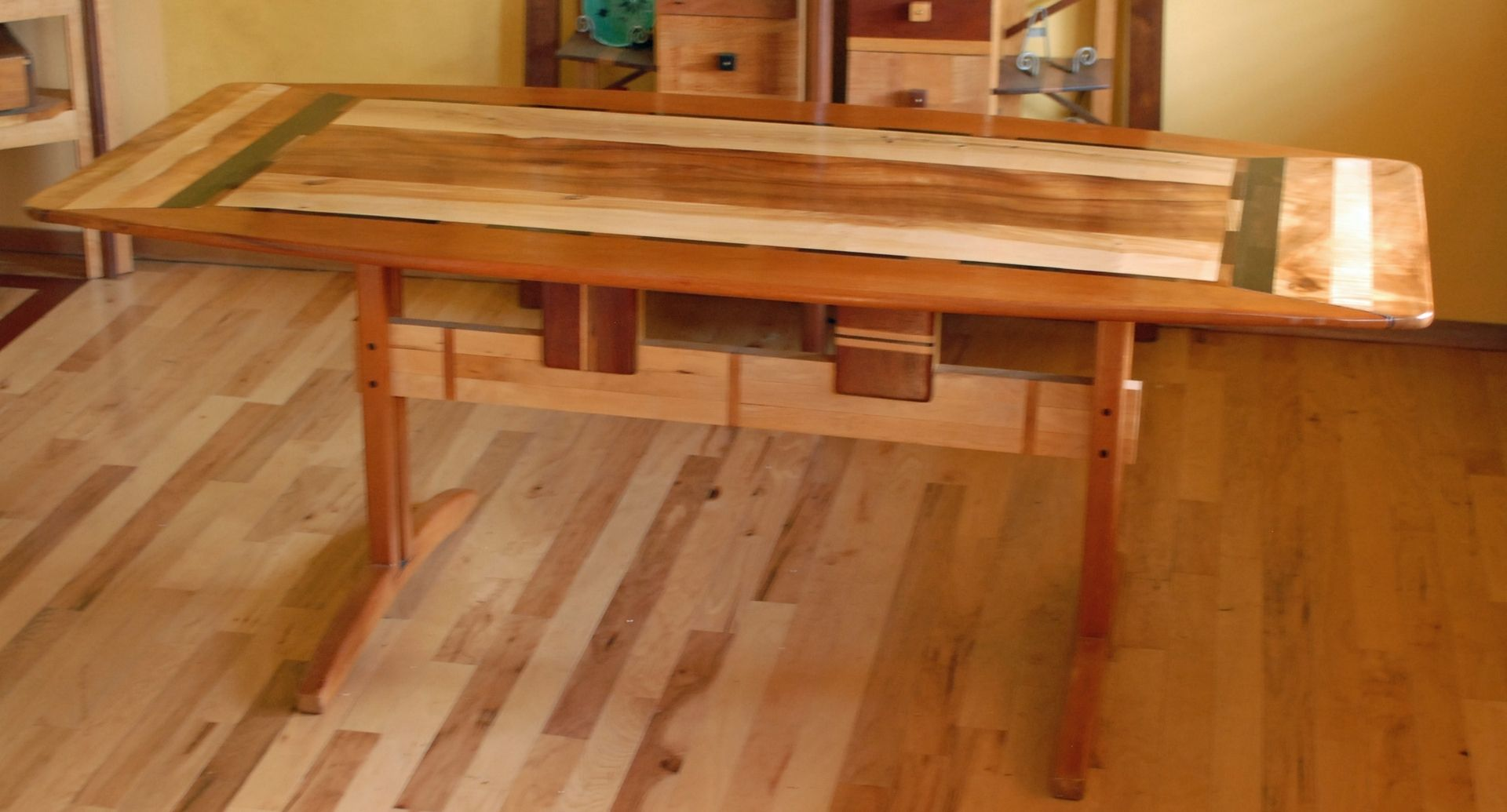 custom made trestle dining room table in koa and spanish