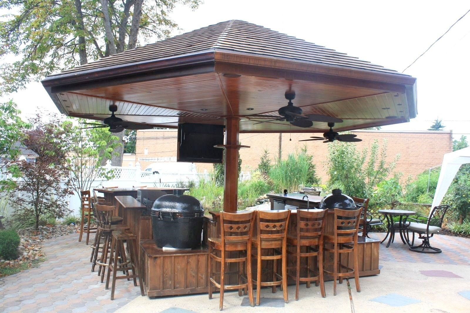Handmade primo grill outdoor kitchen and bar by deck for Outdoor kitchen roof structures