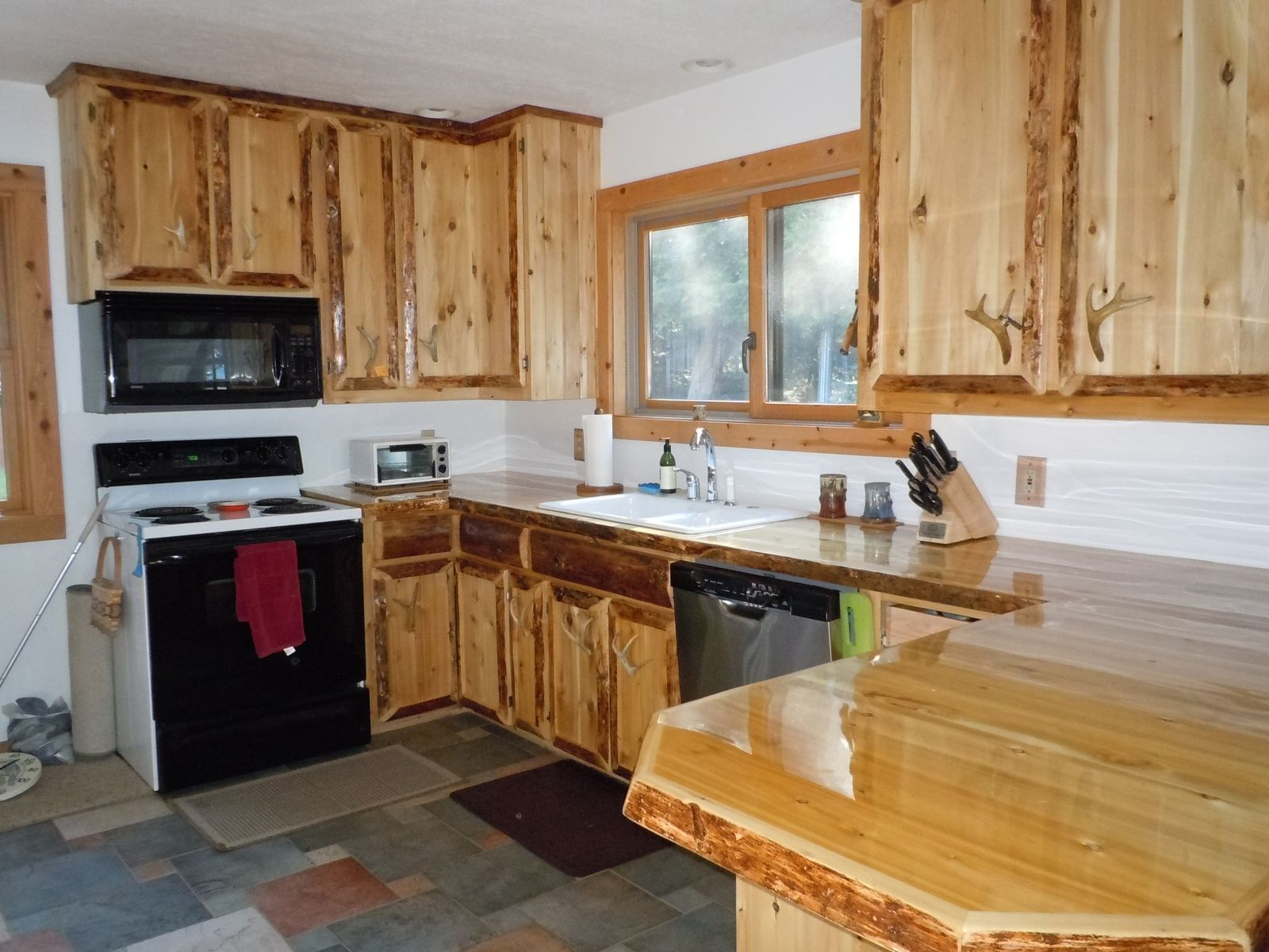 Hand crafted custom cedar kitchen cabinets by king of the forest furniture - Custom made cabinet ...