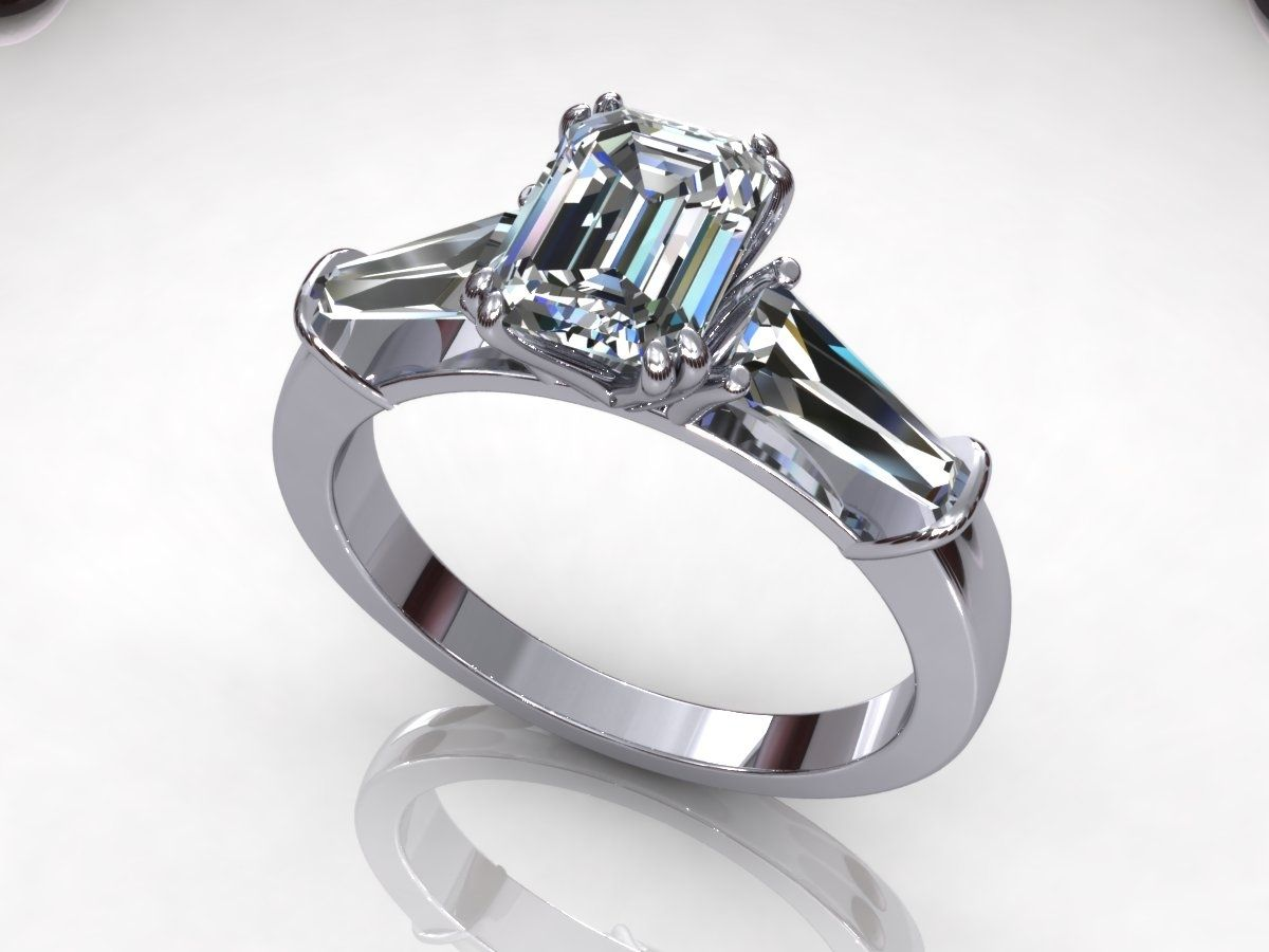 handmade timeless emerald and tapered baguette engagement