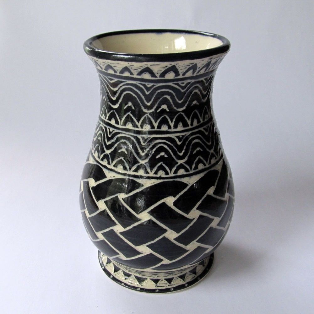 Made handmade stoneware vase with celtic knot and wave carved pattern