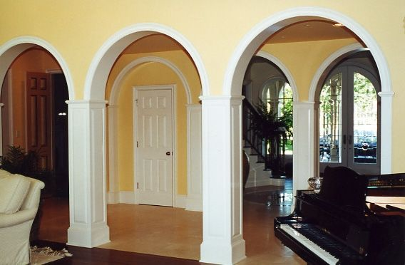 crafted arches raised panel columns and circular molding interior