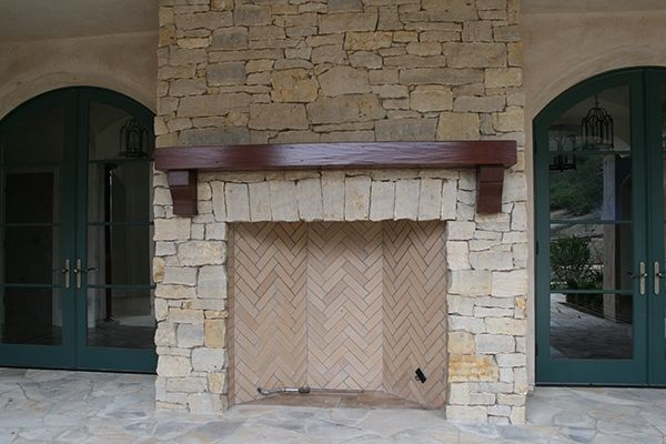custom outdoor fireplace mantle by adney sons